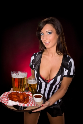 Waitress serving wings and beer